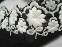 Black base. White  embroidery, stunning!